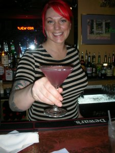 Heather, ready with a smile and a drink
