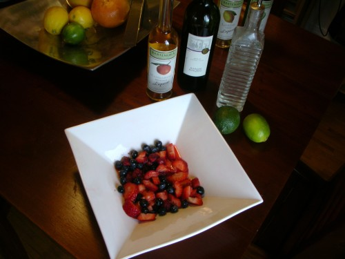 berries macerating with lime juice; merlot, mandarino liquour, and simple syrup ready to pour