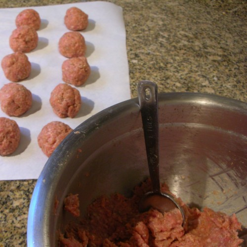 rolling the meatballs, measuring with a tablespoon