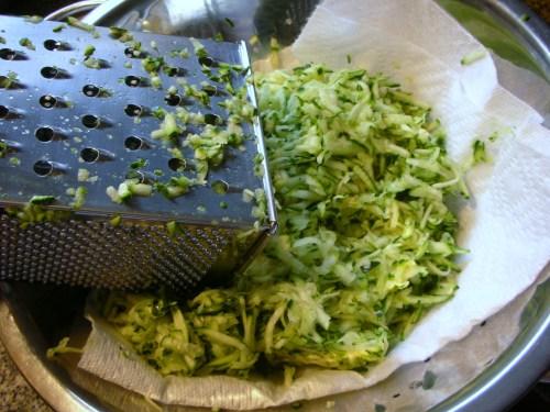 grated zucchini, draining
