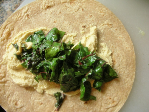sauteed chard with hummus on ww wrap