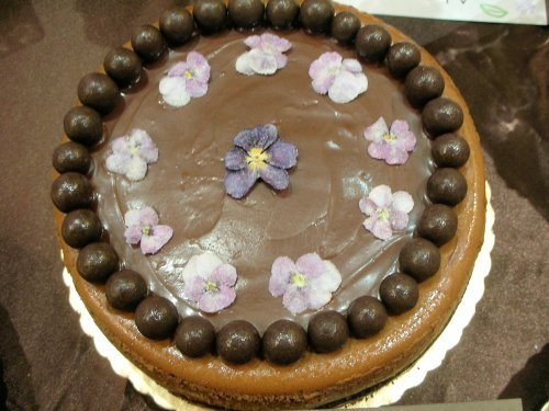 The Baking Architecht's Triple chocolate cheesecake, decorated with crystallized pansies