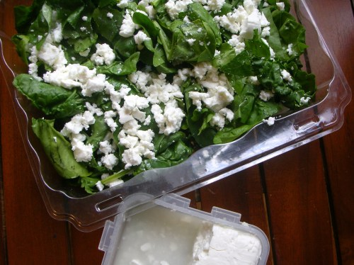 feta crumbled over spinach