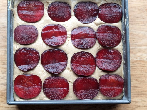 Plum cake with lime and rose, ready for the oven