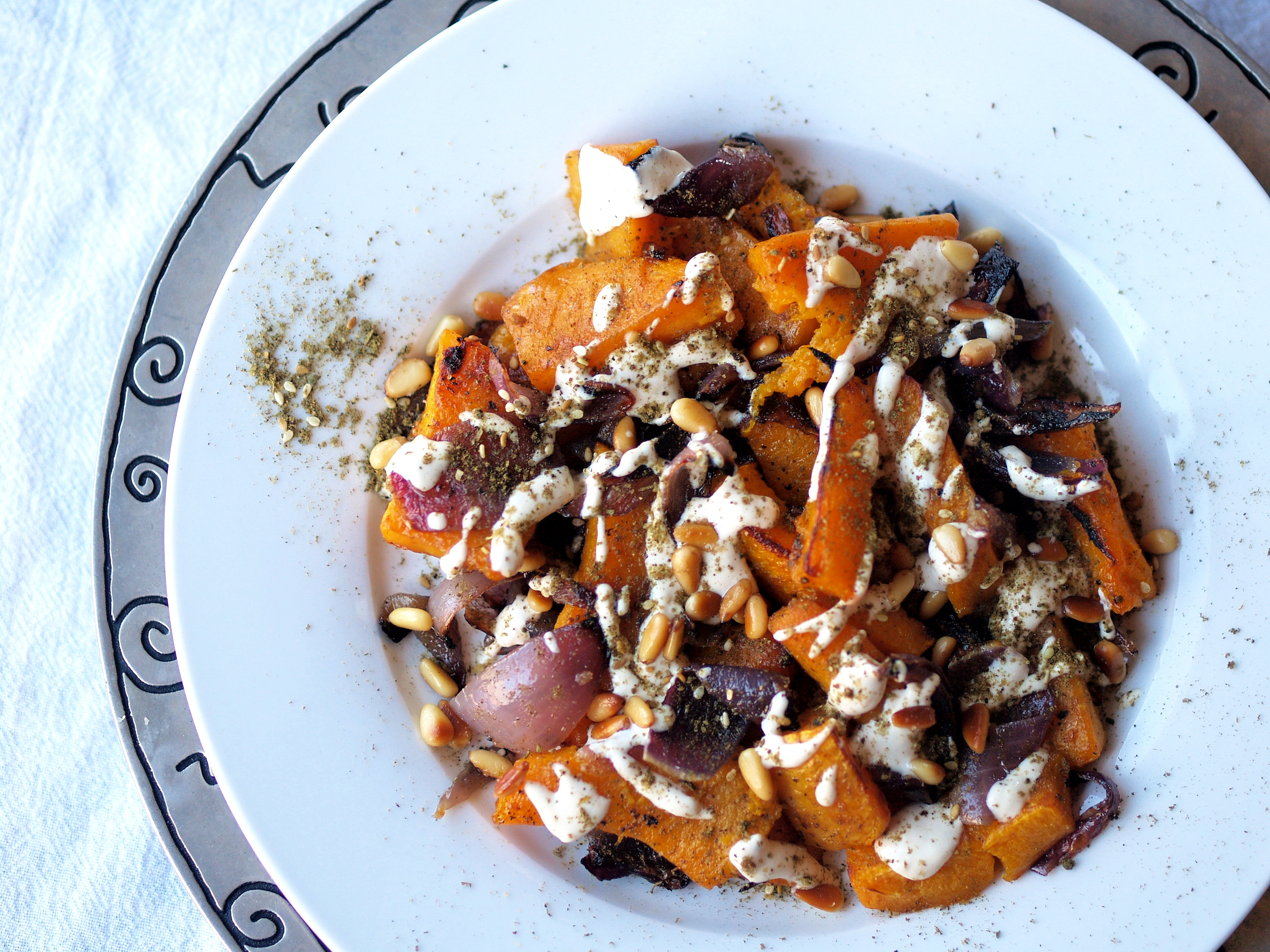 Roasted butternut squash and red onion with tahina and za'atar